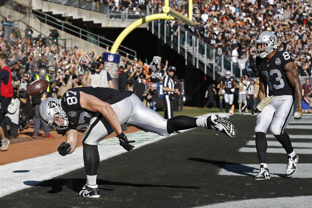 Oakland Raiders tight end Foster Moreau (87) celebrates after scoring a touchdown as tight end ...