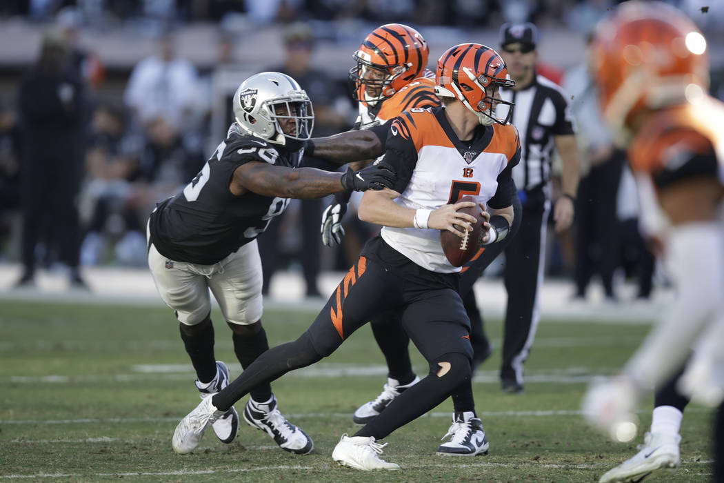Cincinnati Bengals quarterback Ryan Finley runs with the ball away from Oakland Raiders defensi ...