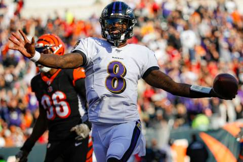Baltimore Ravens quarterback Lamar Jackson (8) celebrates his touchdown during the second half ...