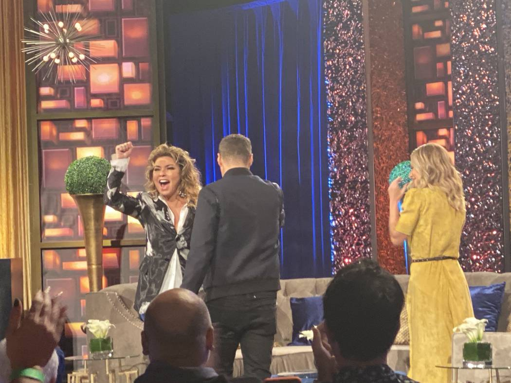 Shania Twain responds to a standing ovation as she is greeted by Ryan Seacrest and Kelly Ripa o ...