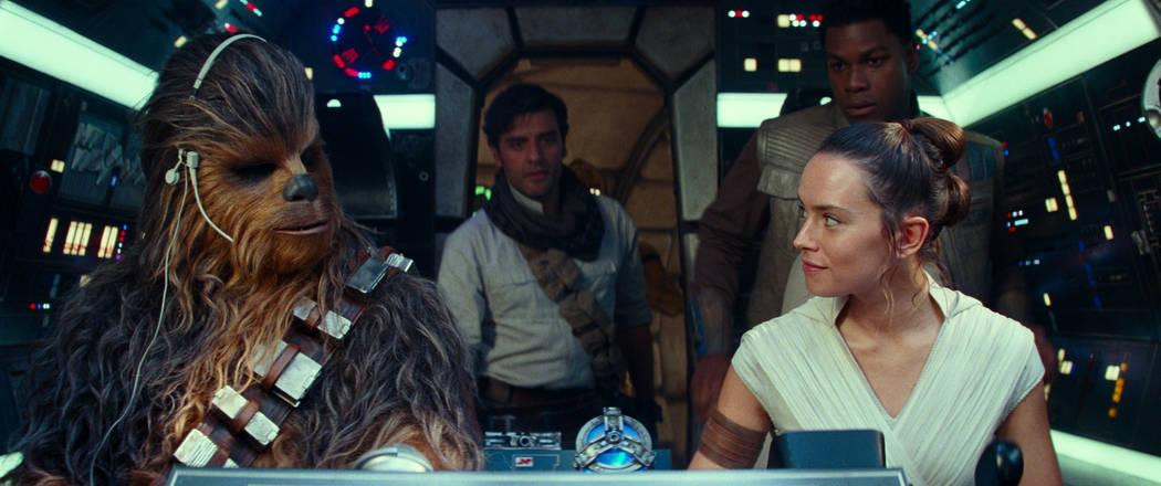 Joonas Suotamo is Chewbacca, Oscar Isaac is Poe Dameron, Daisy Ridley is Rey and John Boyega is ...
