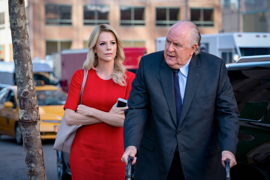 """Charlize Theron as Megyn Kelly and John Lithgow as Roger Ailes in """"Bombshell."""" (Lionsgate)"""