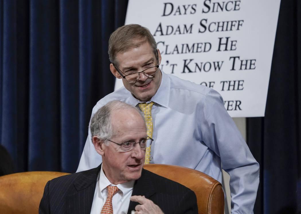 Rep. Jim Jordan, R-Ohio, top, and Rep. Mike Conaway, R-Texas, members of the House Intelligence ...