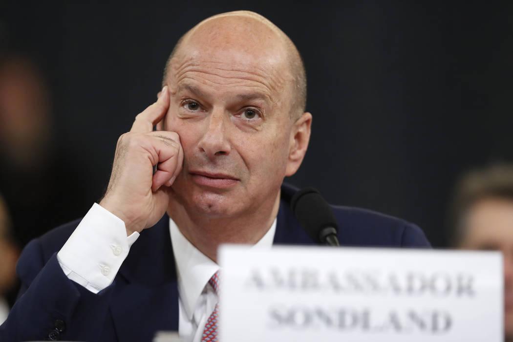 U.S. Ambassador to the European Union Gordon Sondland listens as he testifies before the House ...