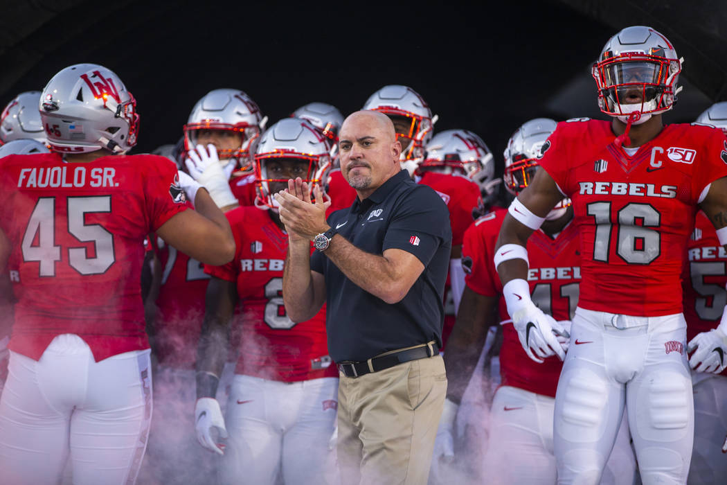 In this Aug. 31, 2019, file photo, UNLV Head Coach Tony Sanchez, center, waits with his team to ...