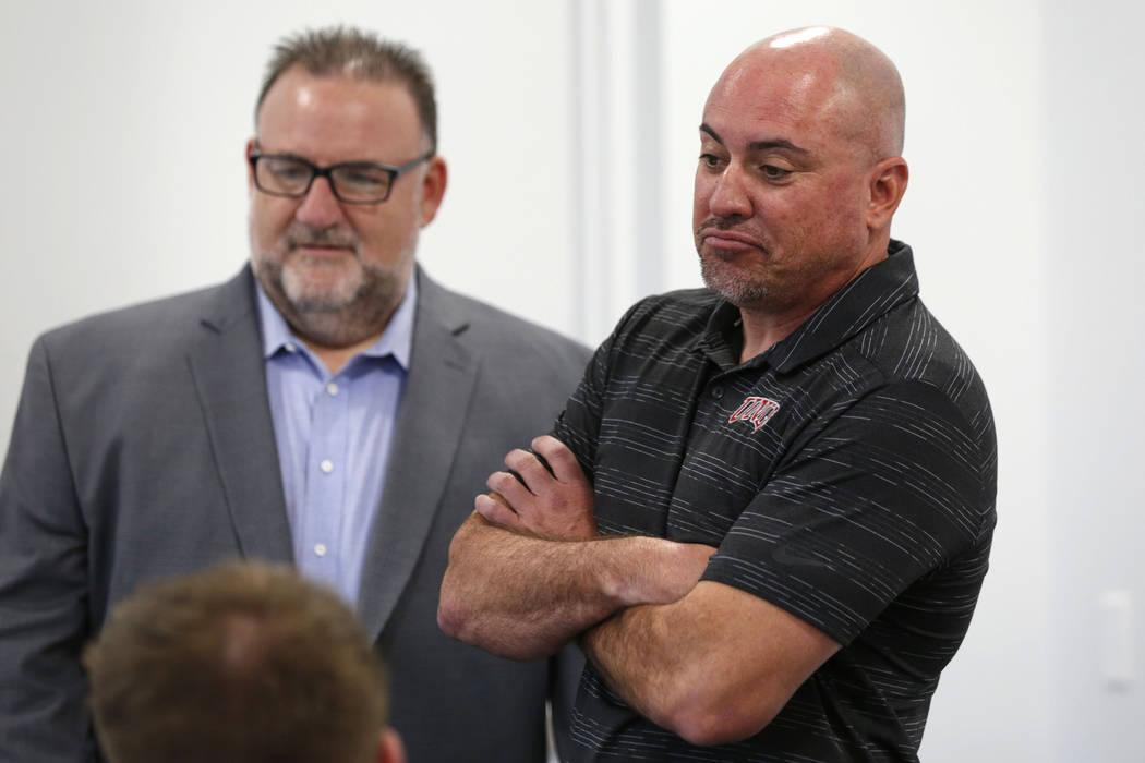 UNLV football head coach Tony Sanchez, right, is seen with Mark Wallington, senior assistant at ...