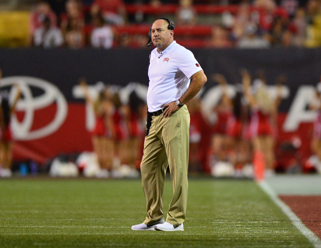 UNLV Rebels head coach Tony Sanchez watches his team play the UTEP Miners at Sam Boyd Stadium i ...