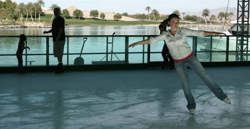 Grace Peuser, 12, figure skates on the floating ice skating rink at the MonteLago Village at La ...