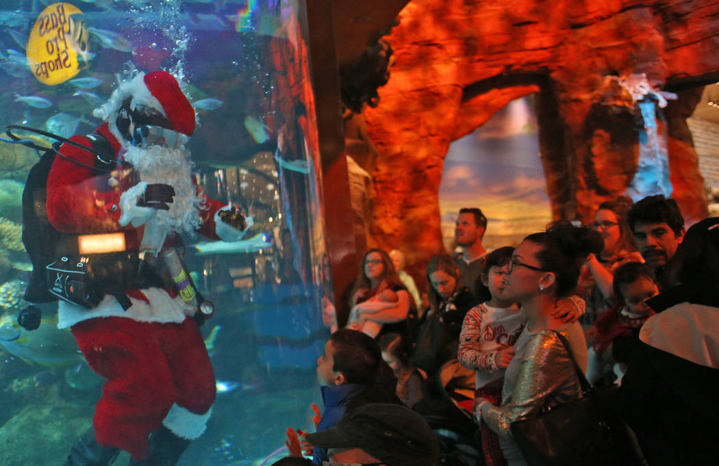 Underwater Santa greets the crowd at Silverton hotel and casino in Las Vegas, Sunday, Dec. 2, 2 ...