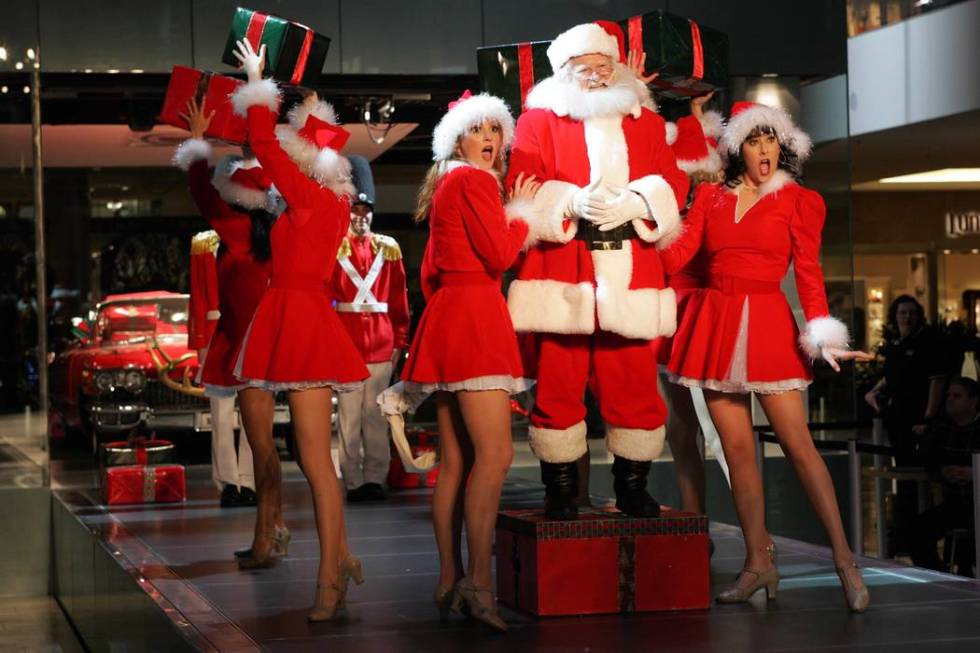 Santa appears on a model runway with dancers at Fashion Show Mall in Las Vegas Thursday, Dec. 9 ...