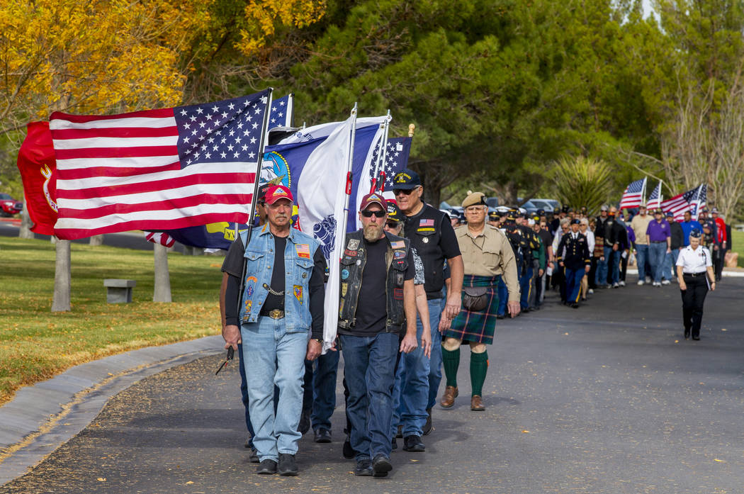 Nevada Patriot Guard Riders carry the American flag and those of all military branches during t ...