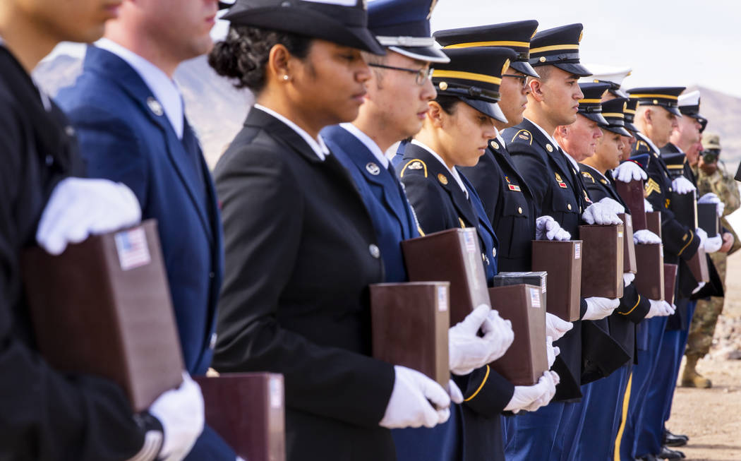Military Honor Guard members with urns arrive at their burial plots during the third Missing in ...