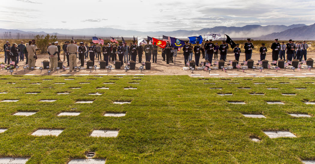 Urns arrive by honorable transfer to their burial plots during the third Missing in Nevada cere ...