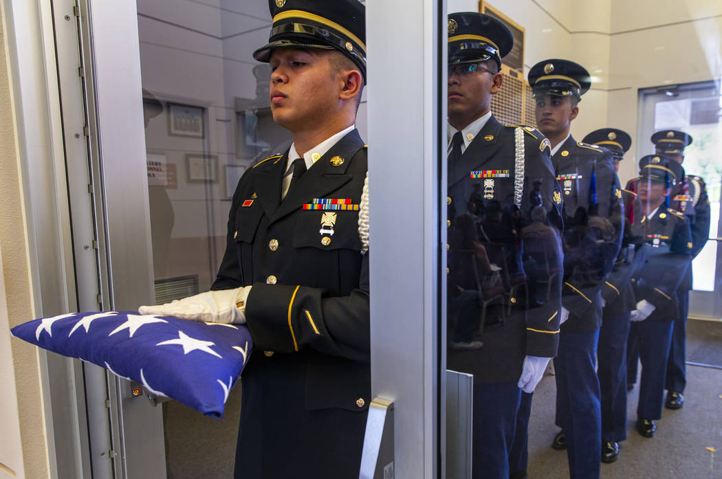 Army Honor Guard soldiers stand at the ready during the third Missing in Nevada ceremony at the ...