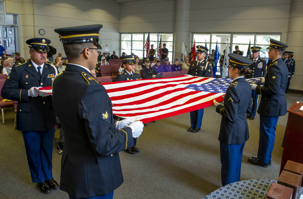 Army Honor Guard soldiers conduct a flag folding presentation during the third Missing in Nevad ...
