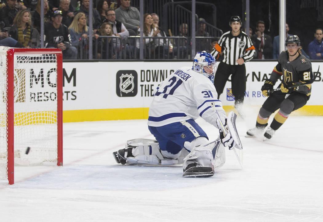 Vegas Golden Knights center Cody Eakin (21) watches his shot go wide of Toronto Maple Leafs goa ...