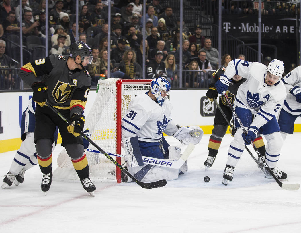 Vegas Golden Knights right wing Reilly Smith (19) shoots on Toronto Maple Leafs goaltender Fred ...