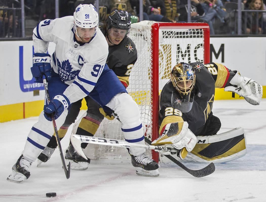 Vegas Golden Knights goaltender Marc-Andre Fleury (29) makes a poke save against Toronto Maple ...