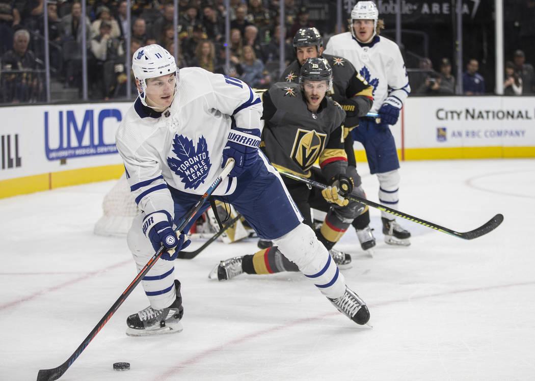 Toronto Maple Leafs center Zach Hyman (11) skates around Vegas Golden Knights defenseman Jon Me ...