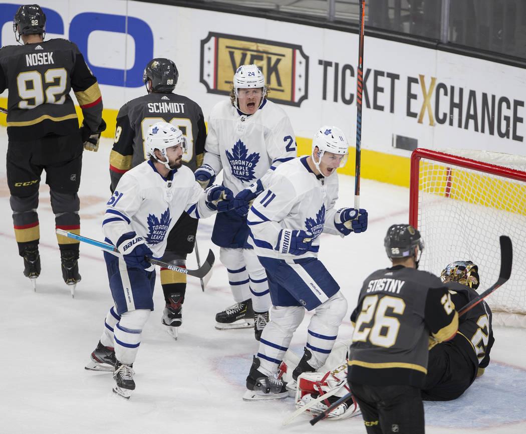 Toronto Maple Leafs center Zach Hyman (11) celebrates with Toronto Maple Leafs center Nic Petan ...