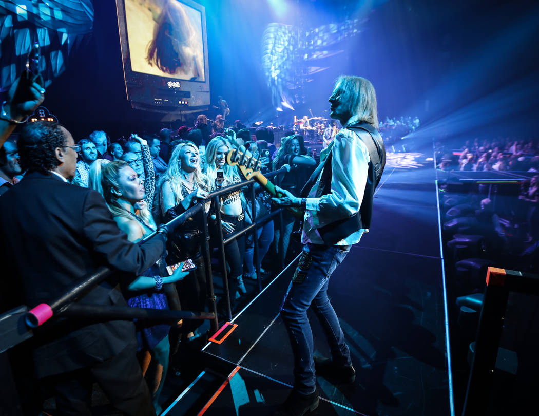 Tom Hamilton of Aerosmith is shown performing on the bar in the onstage VIP section at Park The ...