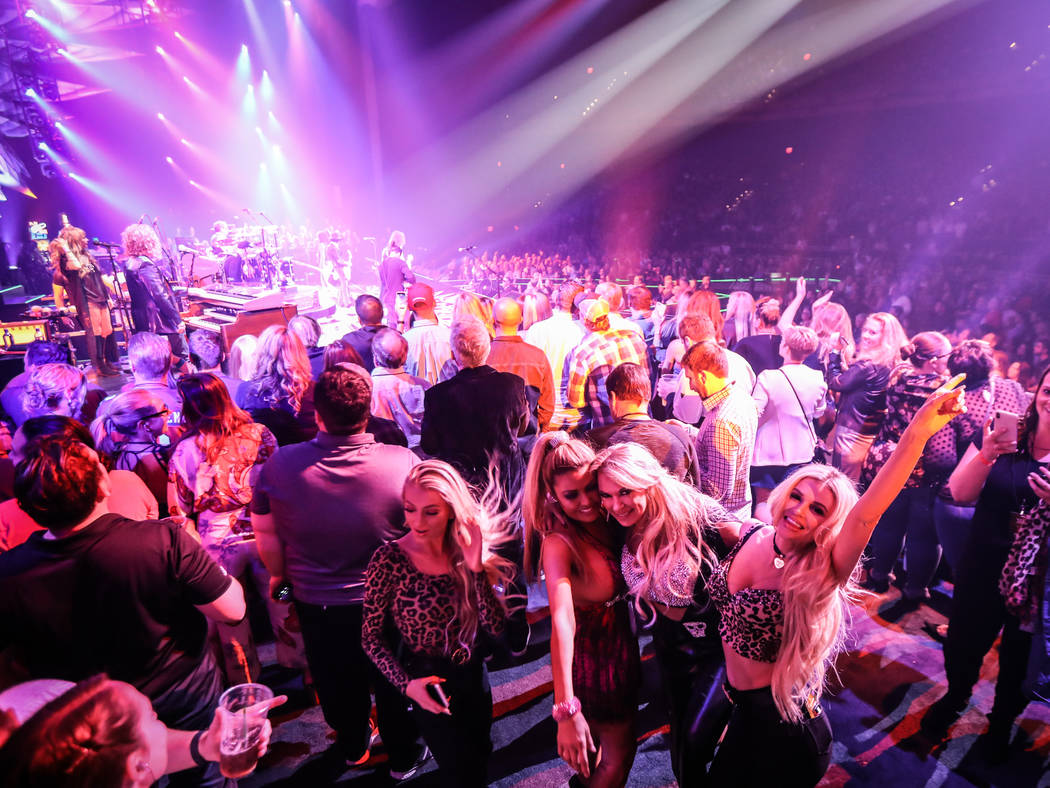 "The onstage crowd on the VIP section for Aerosmith's ""Deuces Are Wild"" production are shown on ..."