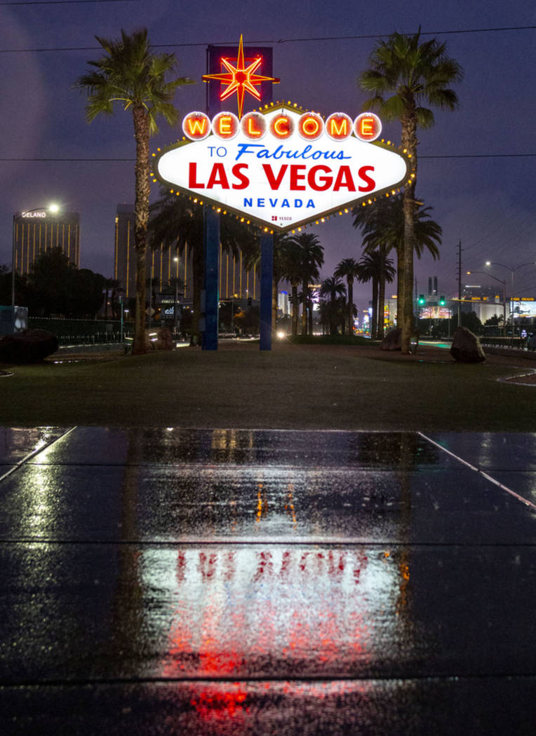 Rain falls at the Welcome to Fabulous Las Vegas sign at the Strip in Las Vegas on Wednesday mor ...