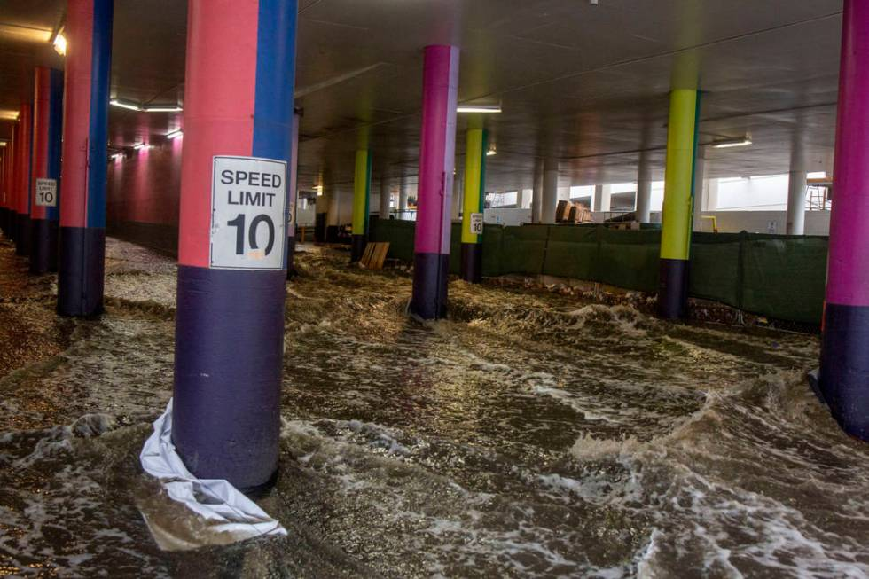 Heavy rain waters cause flooding at the LINQ parking garage on the Strip in Las Vegas on Wednes ...