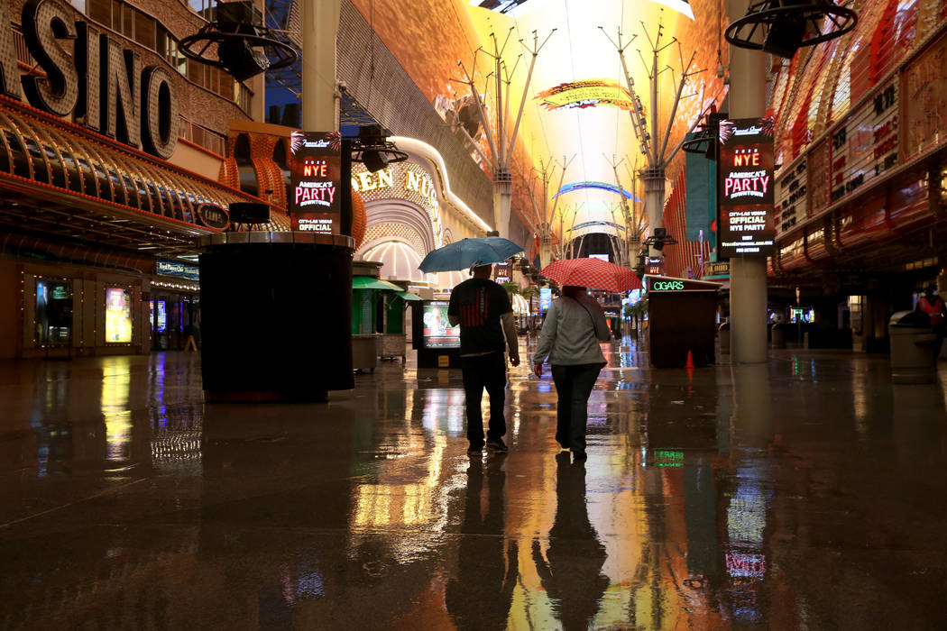 People walk through the Fremont Street Experience in downtown Las Vegas Tuesday, Nov. 19, 2019. ...
