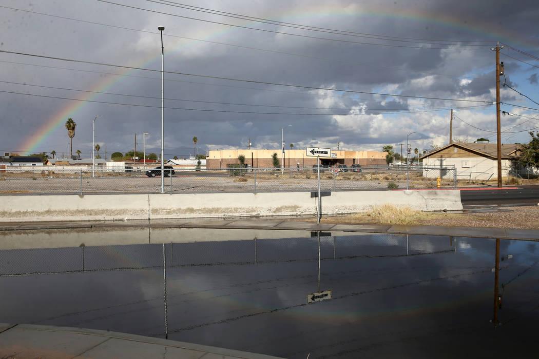 A rainbow over standing rain water on G Street near Owens Avenue in Las Vegas Wednesday, Nov. 2 ...