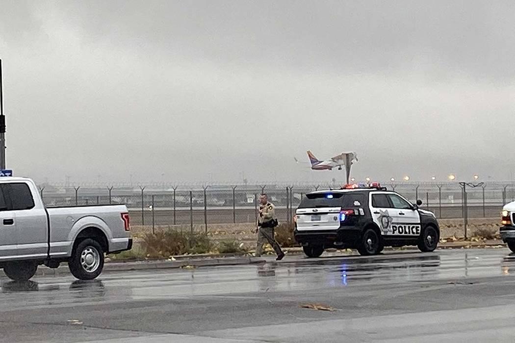 A Las Vegas police officer investigates a minor crash on Sunset Road near McCarran Internationa ...