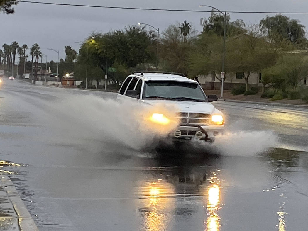 A truck sends a shower of water near Eastern Avenue and Viking Road on Wednesday, Nov. 20, 2019 ...