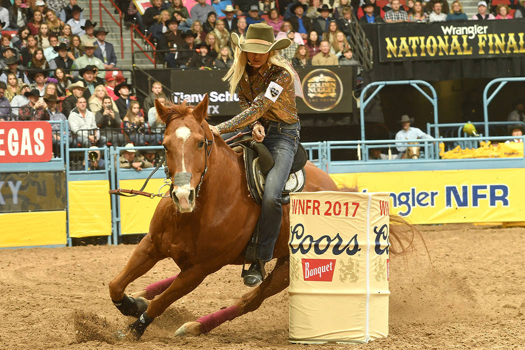 Tiany Schuster rounds a barrel aboard her horse JSYK I'm Famous on Dec. 7, 2017, during the fir ...