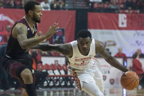 UNLV Rebels guard Amauri Hardy (3) drives past Texas State Bobcats forward Eric Terry (45) in t ...