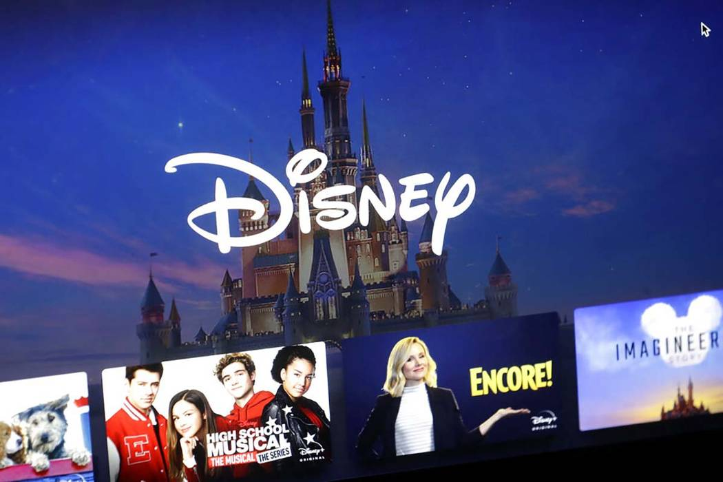 In a Wednesday, Nov. 13, 2019, file photo, a Disney logo forms part of a menu for the Disney Pl ...