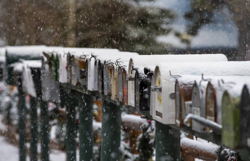 Snow covered mailboxes in Old Town at Mount Charleston on Wednesday, Nov. 20, 2019. (L.E. Basko ...