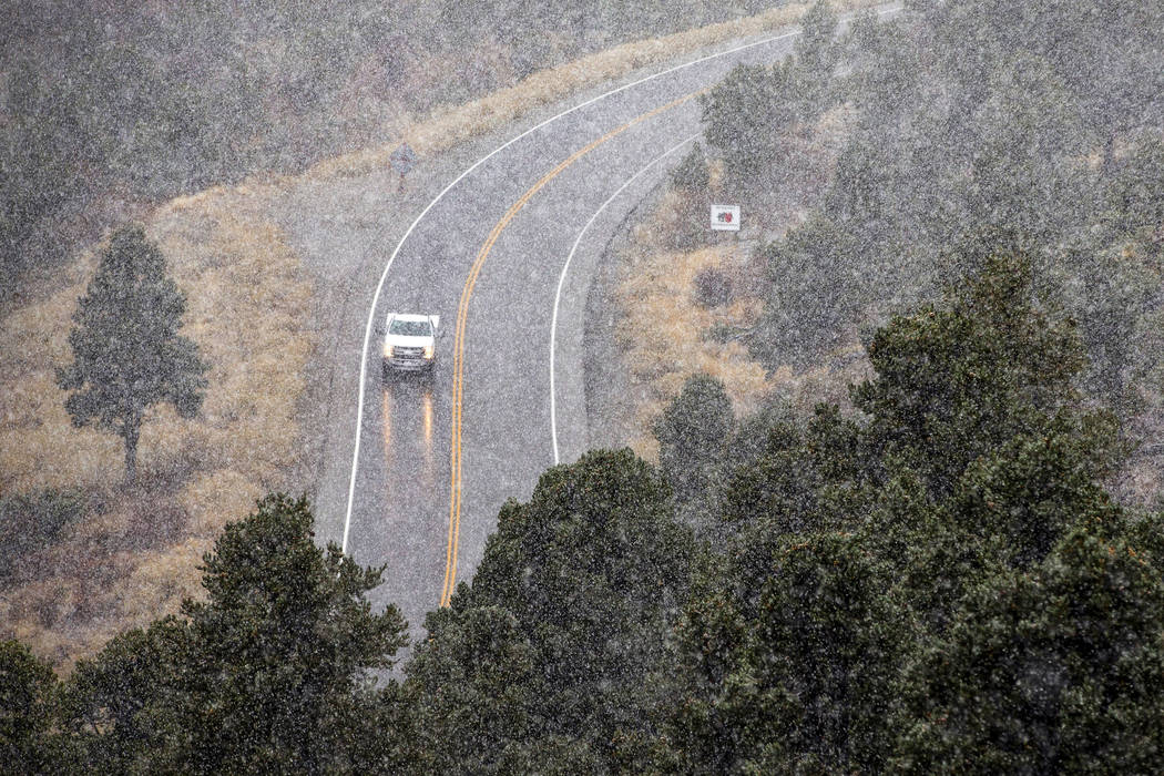Snow falls along state Route 157 on Mount Charleston on Wednesday, Nov. 20, 2019. (L.E. Baskow/ ...