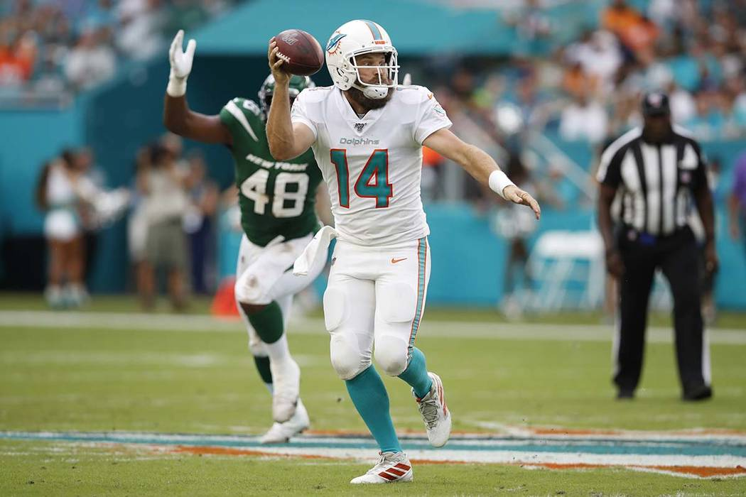 Miami Dolphins quarterback Ryan Fitzpatrick (14) throws a pass against the New York Jets during ...