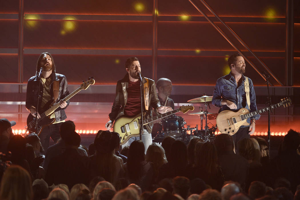 """Geoff Sprung, from left, Matthew Ramsey, and Brad Tursi, of Old Dominion, perform """"No Such ..."""