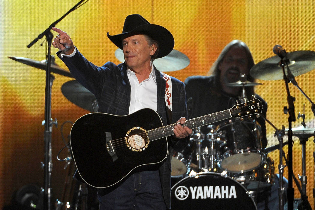 George Strait performs on stage at the 49th annual Academy of Country Music Awards at the MGM G ...
