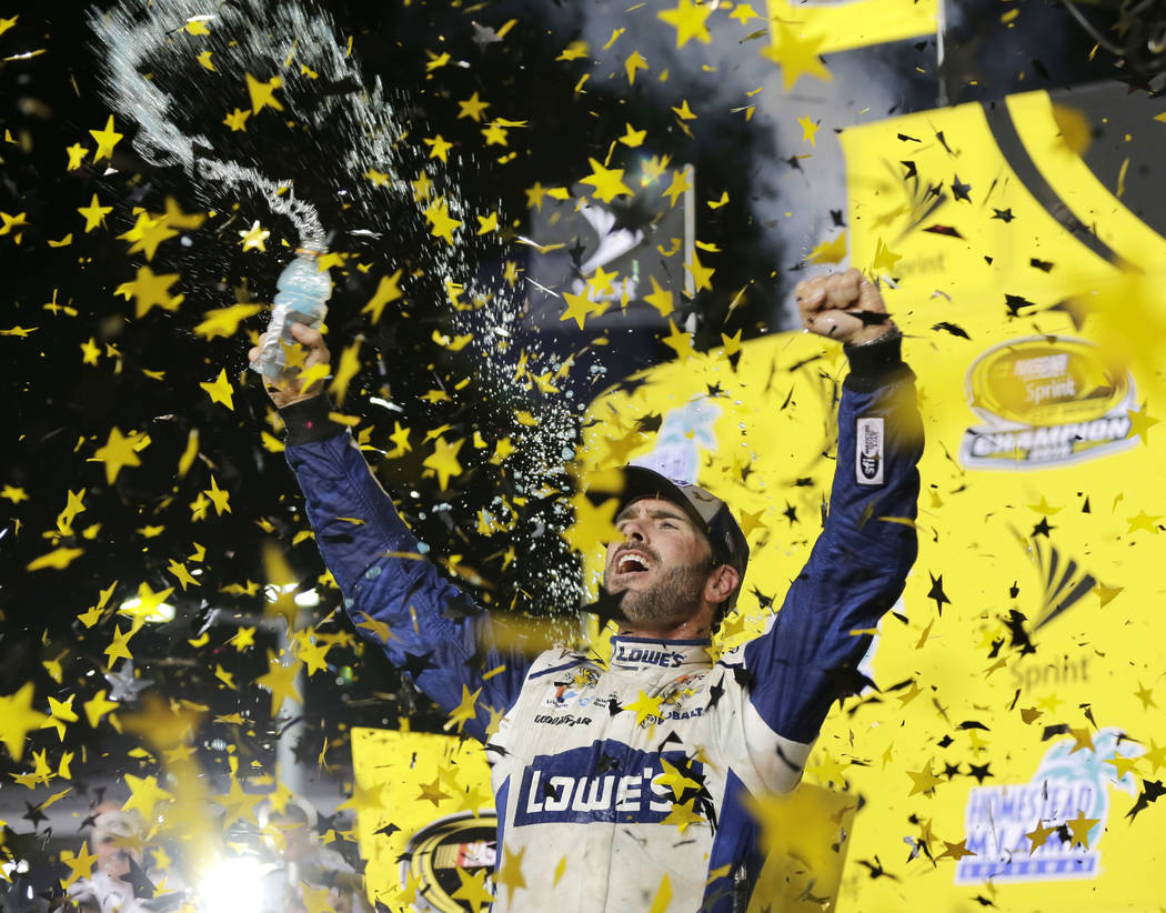 FILE - In this Nov. 20, 2016, file photo, Jimmie Johnson celebrates his NASCAR Sprint Cup auto ...
