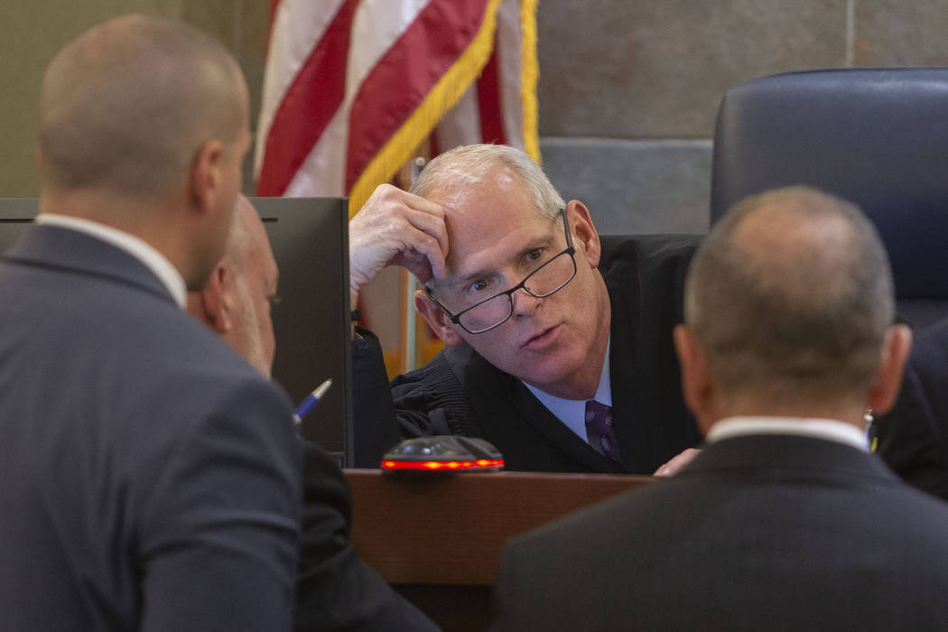 In this Nov. 13, 2019, file photo, Judge Douglas Herndon, center, speaks to state prosecutors a ...
