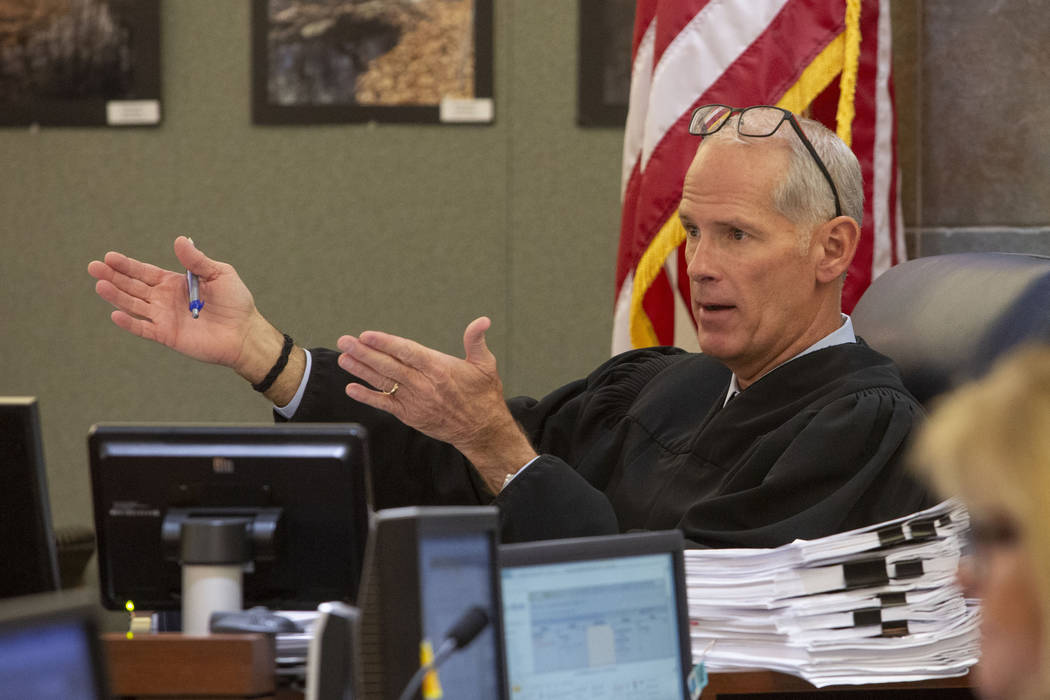 In this Nov. 13, 2019, file photo, Judge Douglas Herndon presides in court during a hearing at ...