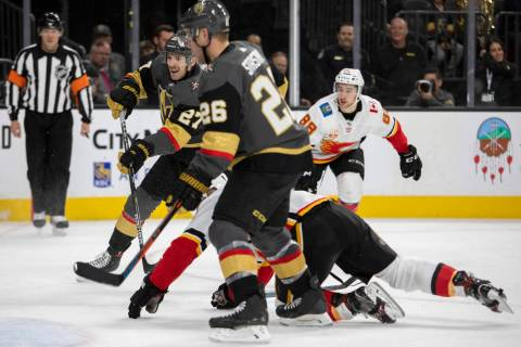 Golden Knights defenseman Shea Theodore (27) makes a shot on goal during the third period of th ...