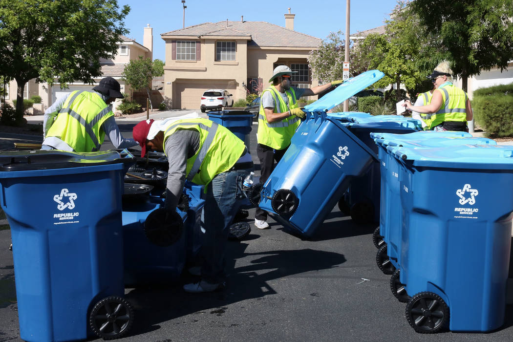 In this June 30, 2017, file photo, Republic Services of Southern Nevada employees deliver new r ...