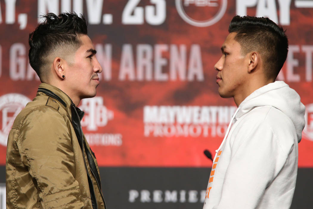 Leo Sant Cruz, left, and Miguel Flores, pose during a press conference at the MGM Grand Garden ...