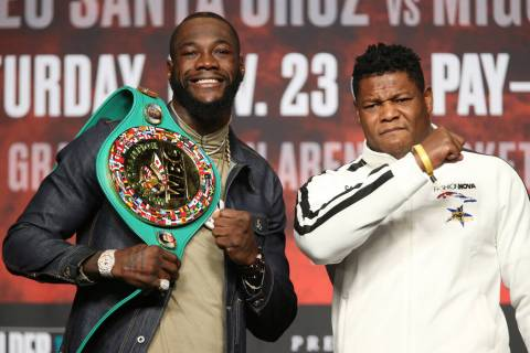 Deontay Wilder, left, and Luis Ortiz, pose during a press conference at the MGM Grand Garden Ar ...
