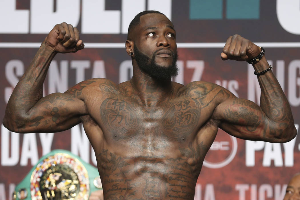 Deontay Wilder stands on the scale during a weigh-in at the MGM Grand Garden Arena in Las Vegas ...