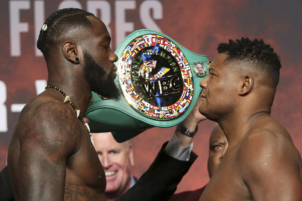 Deontay Wilder, left, and Luis Ortiz, pose during a weigh-in at the MGM Grand Garden Arena in L ...