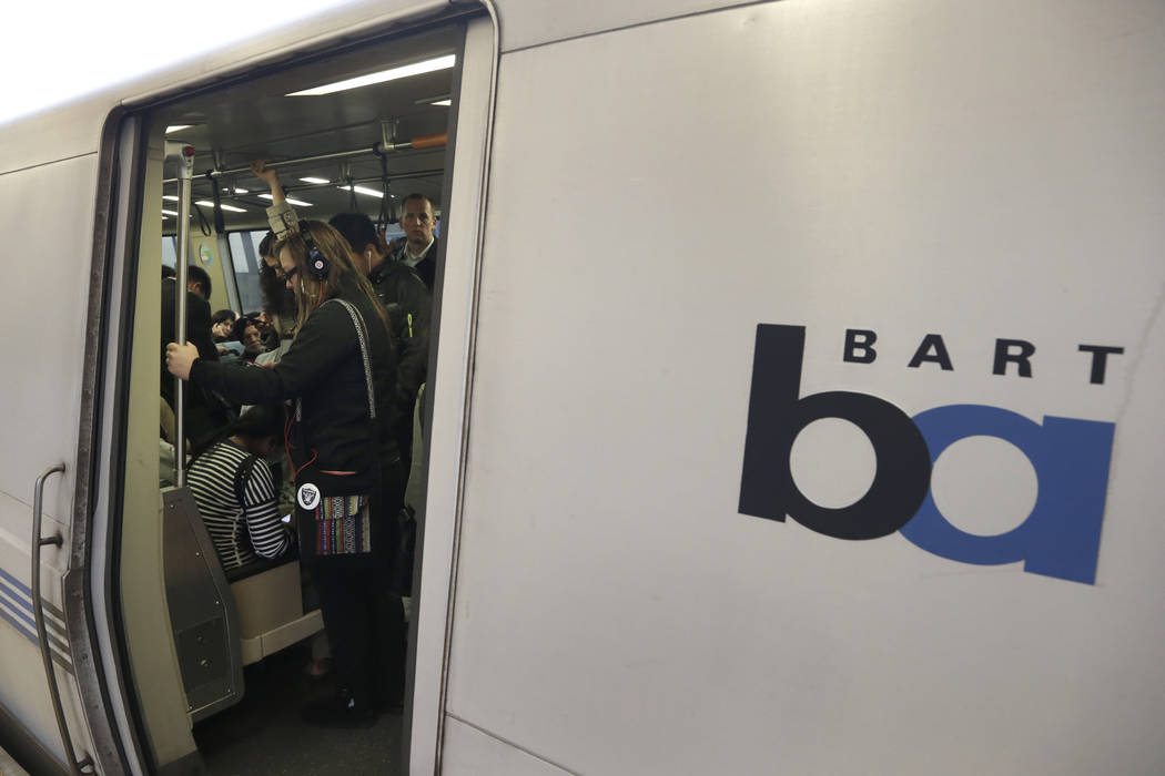 FILE - In this Oct. 22, 2013, file photo, Bay Area Rapid Transit passengers wait for a BART tra ...
